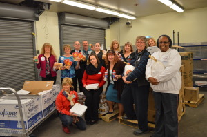 "Aquarius team members help donate boxes of food to the Women's Club in Needles, CA that were then distributed to families in need for Thanksgiving, as part of Aquarius' third annual ""Feed A Family"" program."