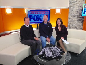 Mike Hix of First Independent Bank, Rick Stevens of Boys and Girls Club of Truckee Meadows and Fox 11's Samantha Boatman.